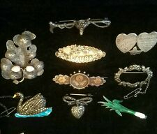 Job lot of antique silver brooches