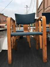 One (1) Thonet Bentwood Antique chair with arms and padded seat.