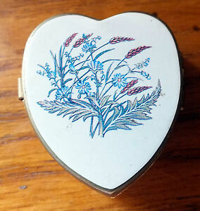 Heart shaped metal pill box with flowers on lid Plastic lining with two sections