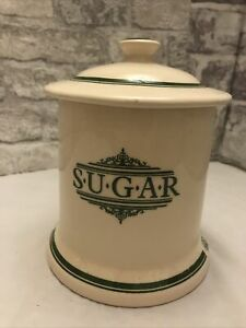 The 1869 Victorian Pottery Sugar Pot in cream with Green writing.