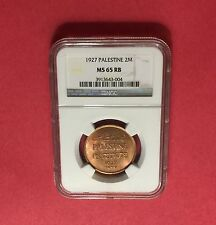 PALESTINE -UNCIRCULATED 1927 2 MILS ,CERTIFIED BY NGC MS65 RB ...rare grading.