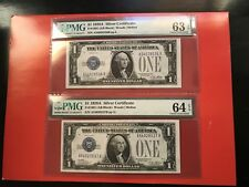 (2) $1 1928A SILVER CERTIFICATES PMG 63/64EPQ UNCCIRCULATE CONSECUTIVE SERIAL #