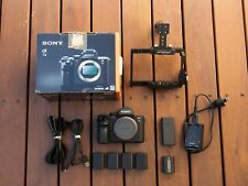 Sony A7ii Mirrorless Camerawith 5 batteries and Video Cage (9360 actuations)