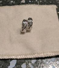 14kt White Gold Diamond Huggies Earrings