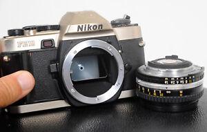 Lovely NIKON FE10 Auto plus Manual 35mm Film Camera + 50mm f1.8 lens...working!
