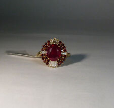 10k Yellow Gold 6.70ctw Oval Ruby, Round Red Garnet & Baguette White Zircon Ring