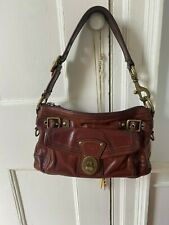 Preowned brown leather Coach shoulder bag with brass hardware