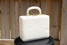 VINTAGE PRESTIGE IVORY OSTRICH PURSE WITH RED LEATHER INTERIOR
