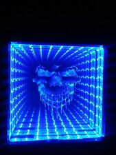 Infinity Mirror with color changing LEDs and 44 key wireless remote.SKULL MIRROR