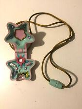 Polly Pocket mini Spieldose Medaillon lila Stern1 Figur Bluebird