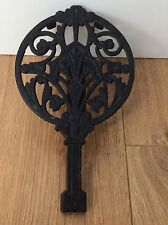 Antique Ornate cast iron trivet for cooker/aga/fireside  with adjustable base.
