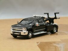 dcp/greenlight dually black Chevrolet 3500 crew cab tow truck 1/64.