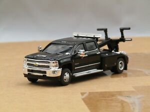 dcp/greenlight dually black Chevrolet 3500 crew cab tow truck 1/64. new