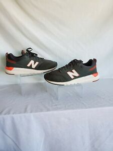 New Balance Men's Defense Green with Orange Trims Sneakers in a size 12