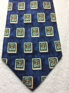 THE DISNEY STORE MENS TIE NAVY BLUE WITH GREEN AND TIGGER 4 X 59