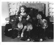 Shirley Temple 8x10 photo sitting amongst cameras holding rifle!
