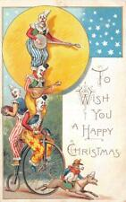 CLOWNS MANDOLIN BANJO MONKEY DOG UNICYCLE CHRISTMAS HOLIDAY UK POSTCARD 1906