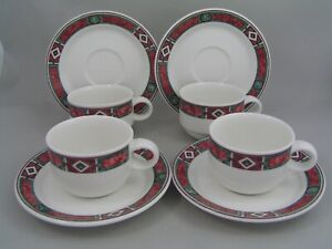 FOUR VILLEROY & BOCH CORPO LOW CUPS AND SAUCERS.