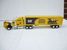 Norscot - Schaal 1/50 - Peterbilt 389  TrailKing Lowkow met With Cat D8R Series