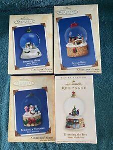 "Hallmark Keepsake ""WINTER WONDERLAND"" Collector's Series. Set of 4 Snow-globes."