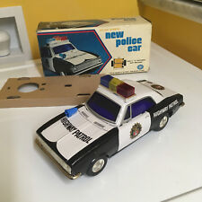 VINTAGE MASUDAYA (MODERN TOYS), TIN, NEW POLICE CAR FULLY WORKING W/BOX. SWEET!