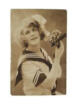 Vintage Real Photo Postcard Beautiful French Lady with Flowers and a Bow 1910s?