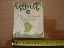 Etiquette RHUM blanc agricole GUYANE collee sur une feuille