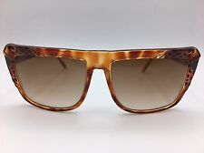 Brown leopard pattern sunglasses with brown tinted lenses