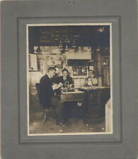 ANTIQUE IMAGE OF THREE MEN. ONE ON A PHONE, AND TWO AT A TYPE WRITER.