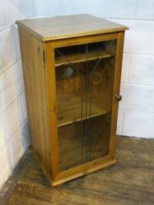 SOLID PINE HI-FI CABINET WITH A GLAZED DOOR.