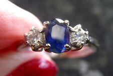 WHITE 18ct GOLD .20 POINT DIAMOND .50 POINT ROYAL BLUE SAPPHIRE TRILOGY RING L/M