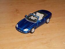 Jaguar XK8. Maisto 1,43.