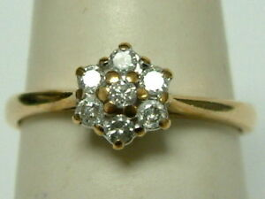 SWEET 9CT GOLD SEVEN STONE DIAMOND CLUSTER RING - 0.25 CARATS