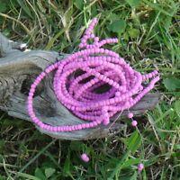 4 fils de perle Coco rocaille de 40 cm chacun diamétre 4 mm +/- (Fuschia)