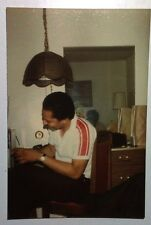 FOUND COLOR PHOTO BLACK AFRICAN MAN HAVING DRINK IN CHAIR LAUGHING OLD LAMP