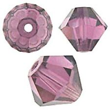 Swarovski Crystal Bicone Amethyst. 6mm. Approx. 48 PCS. 5328
