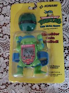 1991 Teenage Mutant Ninja Turtles   Konami TMNT LCD   Wrist Video Game - NEW!