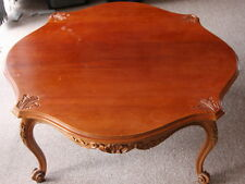 Cedar coffee table carved in the French style of Louis XV