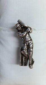 Silver cricketer pin