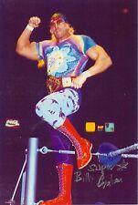 BGP5  Superstar Billy Graham signed 8x10 w/COA  **BONUS**  posed on turnbuckle