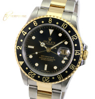 Rolex Mens GMT-Master II 16713 Gold and Steel Black Dial Oyster Band 40mm Watch