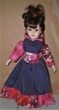 porcelaine doll with dress designed and made by jean duffus
