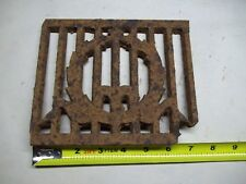Broken part of antique furnace or stove vent or grate ? with design