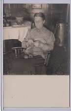 RPPC - Old Woman Knitting in Rocking Chair - early 1900s