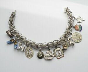 VINTAGE STERLING SILVER CHARM BRACELET. MADE BY AIRFLEX, USA. WEIGHS 32 GRAMS.