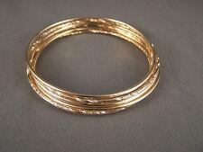"Gold tone set pack of 7 metal thin skinny bangle bracelet shiny 2 5/8"" wide"
