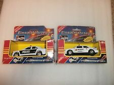 PAIR OF VINTAGE EINSATZFAHRZEUGE DIE CAST CARS MADE IN GERMANY