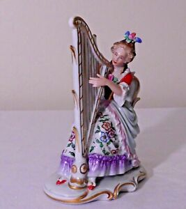 ANTIQUE DRESDEN FACTORY GERMANY FIGURINE OF A WELL DRESSED WOMAN PLAYING A HARP