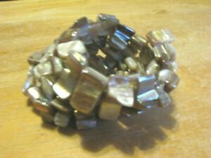 TAN N WHITE MOTHER OF PEARL SHELL ON COILED WIRE WRAPS AROUND WRIST FITS 4-6