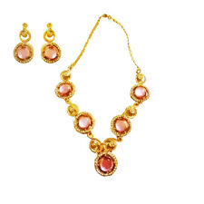 Gold fashion jewelry set with pink stone accents